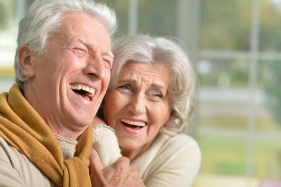 Home care services in Wirral. Domiciliary care and reablement. Elderly couple laughing.